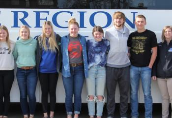 Midkota students and LRSC representatives in front of LRSC bus